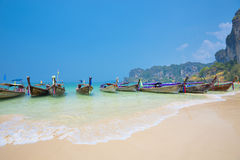 Thailand - May 5, 2016 : Long tail boats wait for tourists at Railay Beach West, Krabi, Thailand Stock Photography