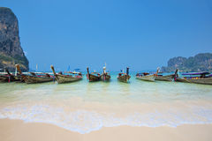 Thailand - May 5, 2016 : Long tail boats wait for tourists at Railay Beach West, Krabi, Thailand Royalty Free Stock Image