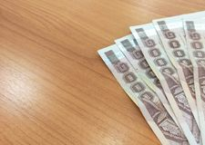 Thailand money notes. On wooden table Stock Photos