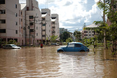 Thailand Monsoon , Cars in water flooded street. S with building Stock Image