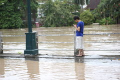 Thailand monsoon , Man on flood Stock Image