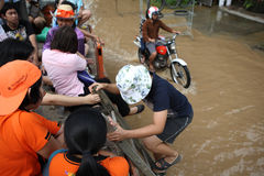 Thailand Monsoon , People climb to truck for Royalty Free Stock Images