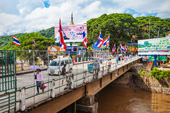 Thailand Myanmar border. MAE SAI, THAILAND - NOVEMBER 04, 2014: Unidentified people crossing border bridge between Thailand and Myanmar stock images