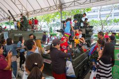 Family and children enjoy fun with military tanks guns and canon army weapons show. Thailand national children day 2018 activity - family and children enjoy fun Royalty Free Stock Photos