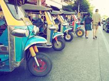 Thailand native taxi call `tuk-tuk` park in row waiting for a tourist passenger. royalty free stock photography