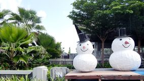 Thailand, new year , palm trees, and snowmen Stock Image