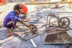 Thailand, November 19, 2016: Welders, repairing cart, garbage, w. Thailand, November 19, 2016: Repair of heating duct. The workers welders made by electric Stock Photos