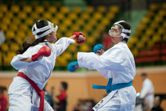 Thailand Open Karate-Do Championship 2013. BANGKOK,THAILAND - SEPTEMBER 9:Female fighters compete in fight during of Thailand Open Karate-Do Championship 2013 on Royalty Free Stock Photography
