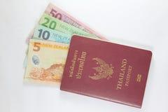 Thailand-Paß und Neuseeland-Geld Stockbild