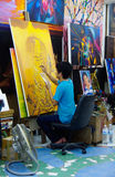 Thailand: painter paints studio yellow Stock Image