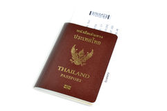 Thailand passport with air ticket in the middle Royalty Free Stock Image