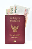 Thailand passport with banknotes Royalty Free Stock Photo