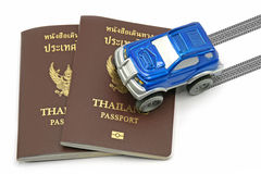 Thailand passport and blue 4wd car for travel concept Royalty Free Stock Photography