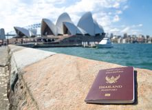 Thailand passport with blurred background of Sydney Opera House for Concepts of traveling. SYDNEY, AUSTRALIA. – On December 14, 2017. - Thailand passport royalty free stock images