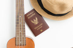 Thailand Passport , brown hat and Ukulele. On white background royalty free stock images