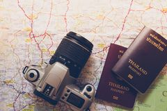 Thailand passport and camera on the map for World travel and travel asia stock images