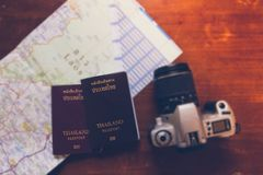 Thailand passport and camera on the map for World travel and travel asia royalty free stock photo
