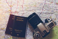 Thailand passport and camera on the map for World travel and travel asia royalty free stock photos