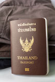 Thailand Passport and clothes stock images
