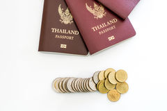 Thailand Passport and coin. Isolated on white background stock photo