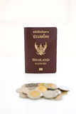 Thailand Passport and coin. Isolated on white background stock images