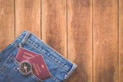 Thailand passport and compass on wood. Close up Thailand passport and compass on wood royalty free stock images