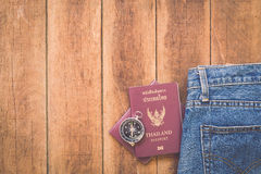 Thailand passport and compass on wood Stock Photo