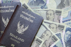 Thailand passport on the currency from japan. Yen stock image