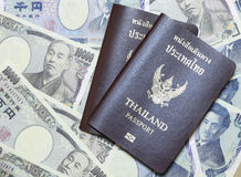 Thailand passport on the currency from japan Royalty Free Stock Photography