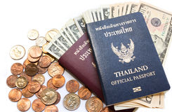 Thailand passport and dollar bill. On white background stock photography