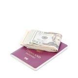 Thailand passport and Dollar USA. On white background stock photos