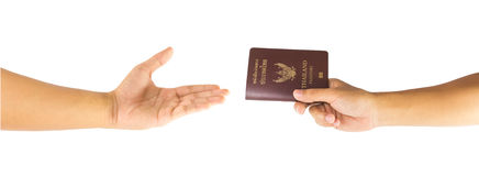 Thailand passport in hand. And open hand isolated on white background royalty free stock photo