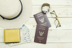Thailand passport, hat, glasses, watch, yellow wallet and cash. royalty free stock photography