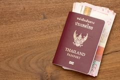 Thailand passport with Hong Kong  currency. Stock Photos