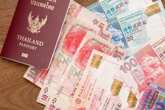 Thailand passport with hongkong currency Stock Images