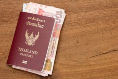 Thailand passport with hongkong currency. Stock Photos