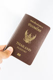 Thailand Passport. In human hand isolated on white background royalty free stock photos