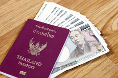 Thailand passport. Japanese banknotes and Thailand passport Royalty Free Stock Photography