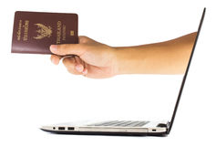 Thailand passport from laptop stock photo