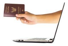 Thailand passport from laptop Stock Photo
