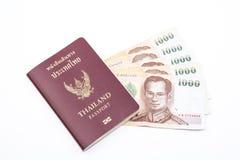 Thailand passport and maney. Thailand passport and thailand money 1000 baht on white background stock image