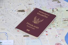 Thailand passport on the map, Prepare to travel. Pathumthani, Thailand - June 8, 2017 : Thailand passport on the map, Prepare to travel. Garuda on the center of royalty free stock photos