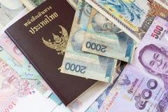 Thailand passport and money. Thailand passport on money background royalty free stock image