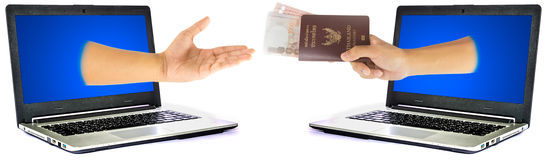 Thailand passport and money from laptop Stock Images