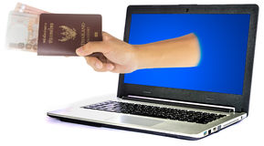 Thailand passport and money from laptop Stock Photos
