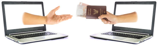 Thailand passport and money from laptop Stock Photography