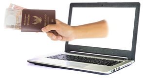 Thailand passport and money from laptop Royalty Free Stock Photos