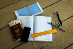Thailand passport with money, pencil and yellow ruler. Thailand passport with money, pencil and yellow ruler for blank notebook write your travel note, mobile stock photo
