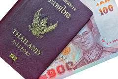 Thailand Passport and money on white background Stock Photography