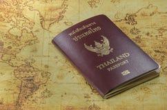 Thailand passport on a old world map. A Thailand passport on a old world map stock photo
